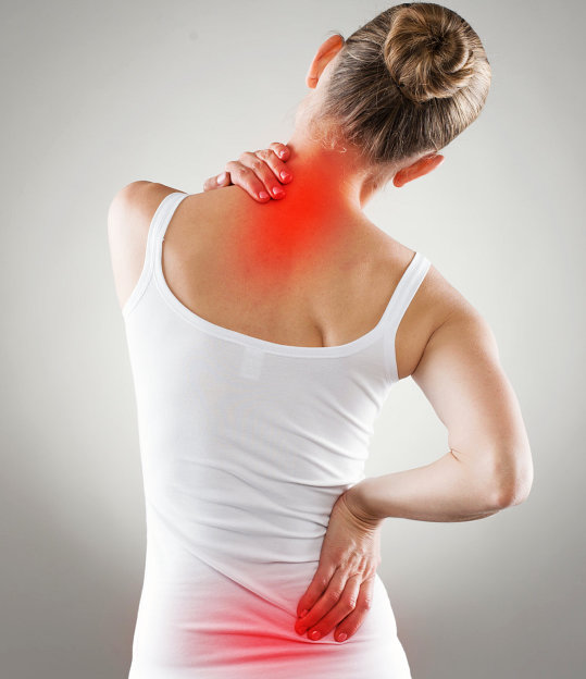 young female experiencing back pain